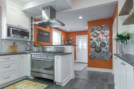 white kitchen cabinets orange walls modern white kitchen with orange accent wall color and