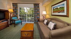 rooms points disney saratoga springs resort spa dining table with chairs sofa coffee and french doors that