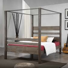 Wood Canopy Bed Frame Oak Wood Canopy Bed Using Bed Linen And White Blanket