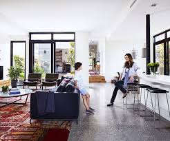 open plan kitchen and living dark grey polished concrete floor