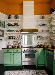 white kitchen cabinets orange walls green kitchen cabinet wooden countertop white wall paint