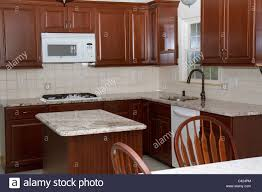 new cherry cabinets granite counter tops and ceramic tile floor