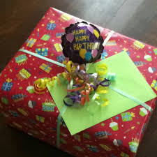 mylar gift wrap using a mini mylar balloon and colorful curling ribbon and wrap make