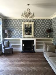 newly decorated lounge in farrow and ball tessella wallpaper and