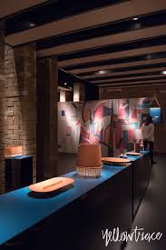 hermes home collections set inside raw brick pavilion in milan