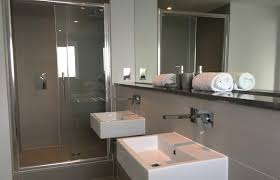 stay 6 ocean gate the ensuite to the master bedroom features a double shower twin sinks and heated towel rail the main bathroom features a bath with shower over toilet
