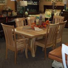 grand island dining table shown in hickory with a natural finish