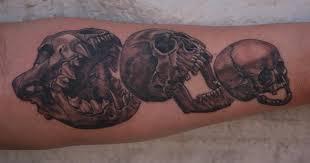 forearm skull tattoos skull eat skull eat skull by larry brogan tattoos