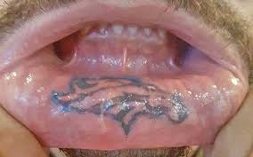 look denver broncos fan gets insane tattoo on his lip cbssports com