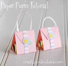 step by step tutorial for making a cute little paper purse with a