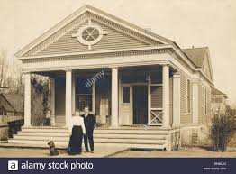 couple at elegant greek revival bungalow stock photo royalty free