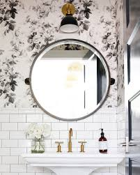 Powder Room Powell Ohio - small powder room with floral wallpaper subway tile and a round
