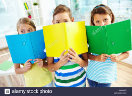 classmates books portrait of happy classmates with books looking at in stock