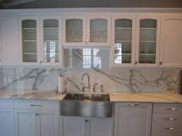 white and blue marble mosaic kitchen backsplash ellajanegoeppinger