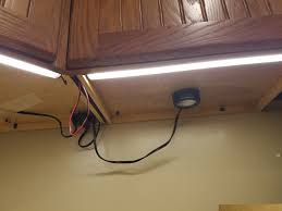 hardwired under cabinet puck lighting under cabinet lighting project has gotten out of hand wife is