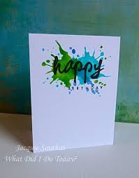 the paint splats were created with a tim holtz stencil and