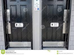 men women black bathroom doors with men push please sign on door