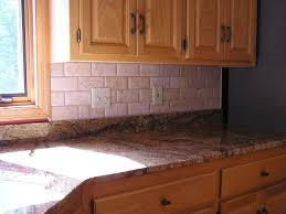 attractive travertine backsplash and pot filler with kitchen