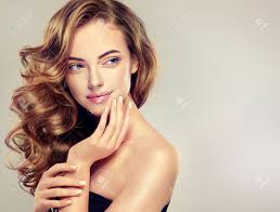 beautiful with long wavy hair brunette model with curly