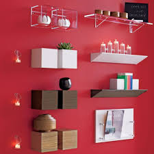 interior get the right nuances for your house decorations wayne interior home wall decoration ideas with wall shelves and wall candle holder on red wall