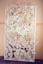 wedding backdrop brisbane flower wall with a neon sign ted and li photography on