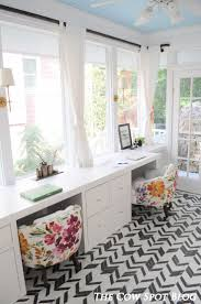 best 25 home office ideas on pinterest office room ideas home blue ceiling flower chairs and black and white floors doesn t get much better the cow spot sunroom turned home office reveal