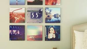 hang picture how to hang pictures in 20 different ways stylecaster
