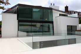 used sliding glass doors minimal windows were used on this residential new build in north