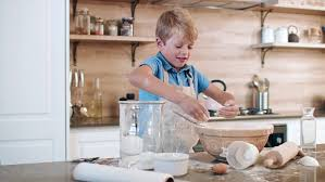 how to make a cake for a boy boy home alone and trying to make a cake pouring