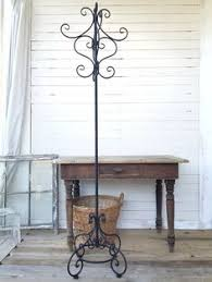 slender black iron coat stand with baskets coat stands wrought