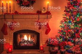 tree with lit fireplace ornaments lights candles