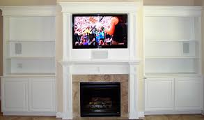 Fireplace Mantels For Tv by Brown Fireplace With White Mantel Shelf And Rectangle Black Tv