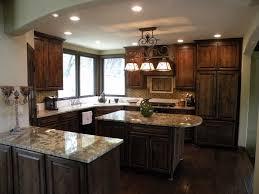 quartz countertops dark brown kitchen cabinets lighting flooring