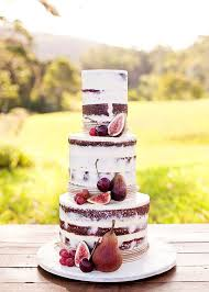 red velvet wedding cake decorated with fresh fruit including