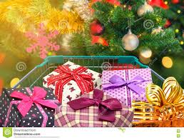 christmas gifts and presents in shopping trolley cart with