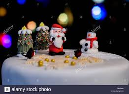 traditional novelty iced fruitcake with tree lights in
