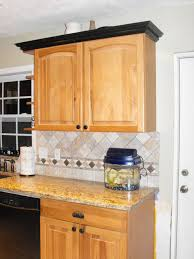 white kitchen cabinets with wood crown molding black crown molding