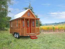 Small House Outside Design by Small House On Wheels Offering Warm Space Saving Interior Design