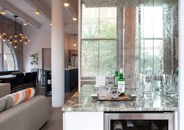 Chandelier In The Kitchen West Village Renovation Transforms A U002770s Loft Into An Elegant