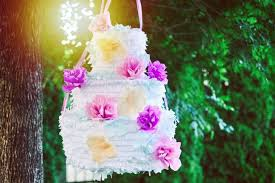 wedding cake pinata ditch traditional cake on their big day and smash open a