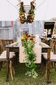 fall wedding centerpieces rustic tented reception with lush