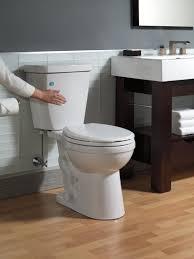 bathroom bathroom sink vanity with graff faucets and daltile wall