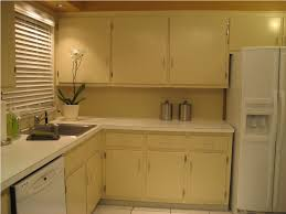 Painting Old Kitchen Cabinets White by Painting Kitchen Cabinets White Before And After Ideas