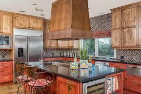 rustic kitchen with flat panel cabinets u0026 mexican tile backsplash