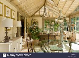 Glass Topped Dining Tables Glass Topped Dining Table In Large Conservatory With Potted Plants