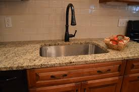 granite countertops with tile backsplash beautiful kitchen