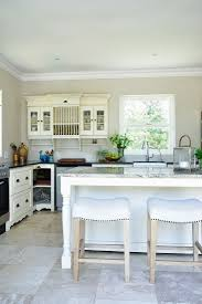kitchen wall mounted cabinets white stools and island counter in front buy image