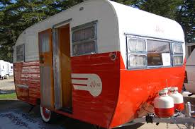 restored 1955 aljoa travel trailer with propane tanks painted red
