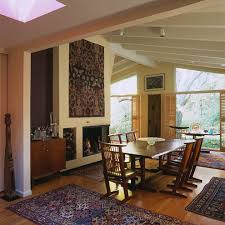 mid century modern baseboard dining room midcentury with oriental rug brick fireplace surround roof line