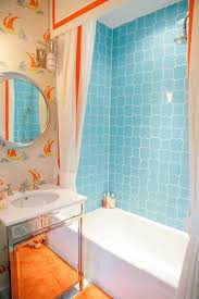 simple blue wall decor in bathtub and interesting white orange